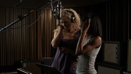 two women in a recording studio