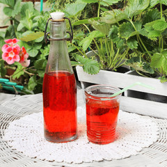 drink in a glass on a table in the garden