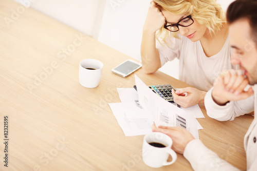 Adult couple working on documents - 82321595