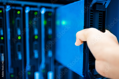 Leinwanddruck Bild People fix server network in data room