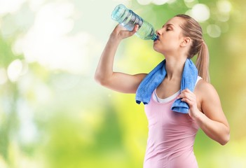 Activity. Fitness beautiful woman drinking water and sweating