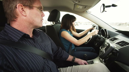 MS Father teaching daughter to drive / Provo, Utah, USA