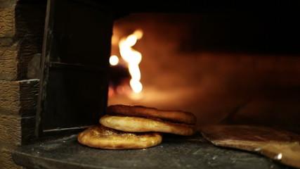 Pita bread in the oven