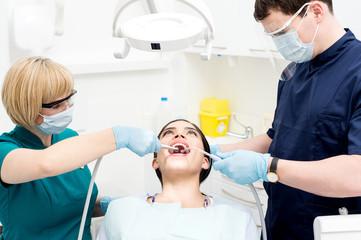 Dentist cleaning a woman teeth