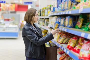 woman buys pasta
