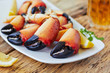 Boiled crab claws on a plate and beer - 82325951