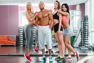 Young sporty people in the gym