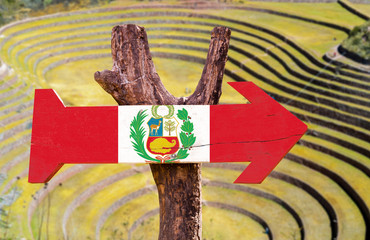 Peru Flag wooden sign with Pisac background
