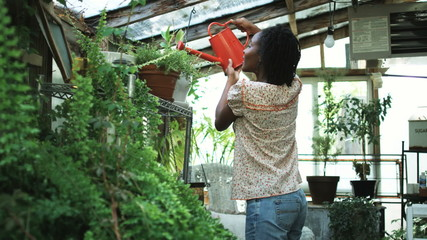 woman working in her greenhouse