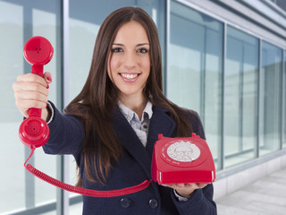 business woman with ancient phone