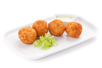 Deep fried cheese balls with  lettuce and white sauce