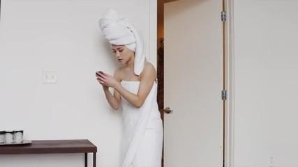 MS Woman wrapped in towel answering phone / Salt Lake City, Utah, USA