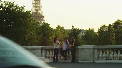 MS Three young women talking on bridge / Paris, France