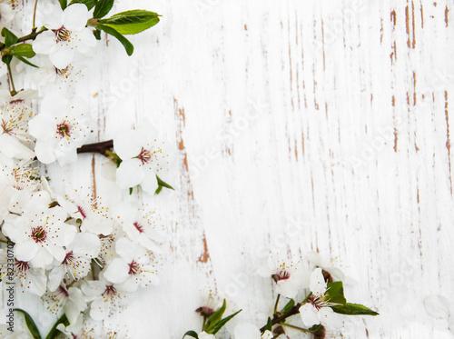 Fotobehang Kersen spring blossom on wood background