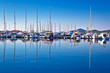 Sailboats and yachts in harbor reflections view - 82331799
