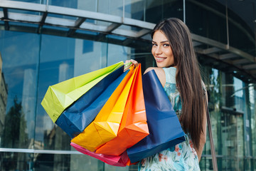 Attractive woman posing with shopping bags