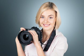 Photographer. Happy female photographer with a camera - isolated