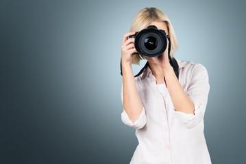 Camera. Girl taking a picture using digital camera