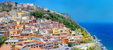Colorful houses and a castle of Castelsardo town - 82336518