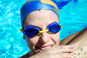 Professional femal swimmer smiling happy closeup