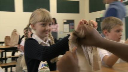 school children comparing lunches