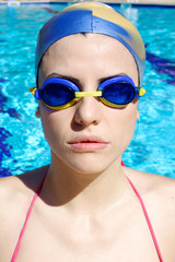 Serious strong professional female swimmer portrait