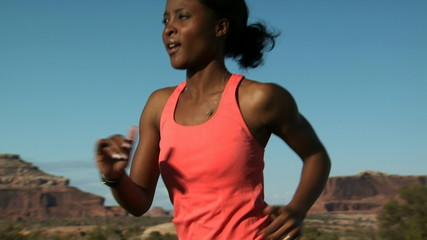 Woman running outdoors with red rocks