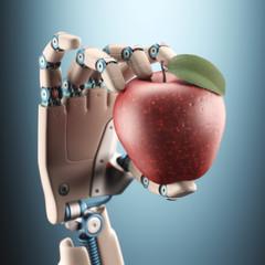 Robotic hand holding an apple