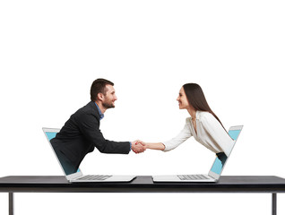 man and woman come out from laptop