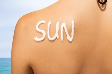 Instagram. The word sun written with sunblock on the back of a