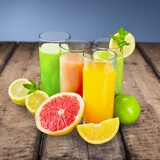 Fotoroleta Fresh. Fresh citrus juices isolated on white