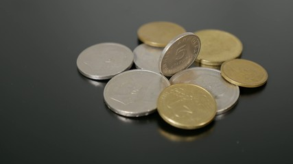 old greek currency (drachma coins) turning
