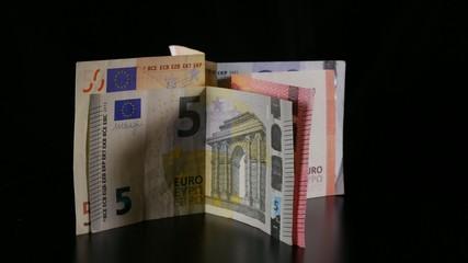 Euro banknotes turning