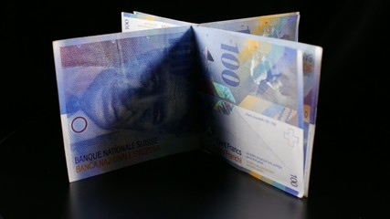 Swiss (Currency) Franc 100 turning on rotary table