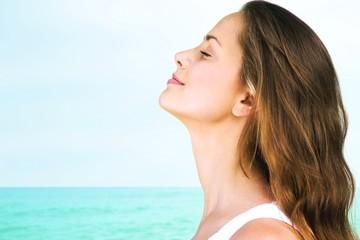 Breathe. Woman profile portrait breathing deep fresh air on the