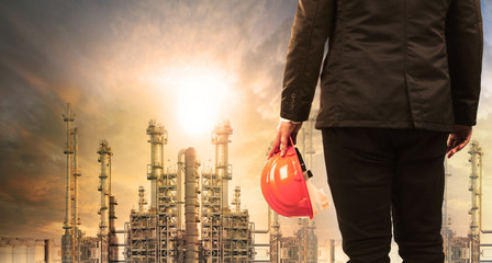 engineering man with safety helmet standing in industry estate a
