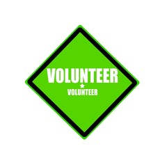 Volunteer white stamp text on green background