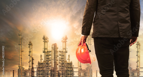 engineering man with safety helmet standing in industry estate a - 82353902