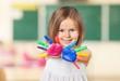 Zdjęcia na płótnie, fototapety, obrazy : Kid. Happy kid playing with paints in his fingers.