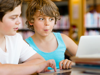 Two boys in library
