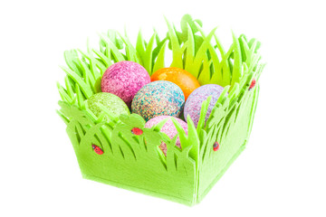 Easter eggs in a basket isolated over white