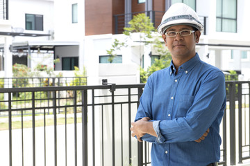 Portrait of  Asian male contractor engineer with hard hat at con
