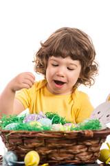 Amazed toddler choose Easter egg