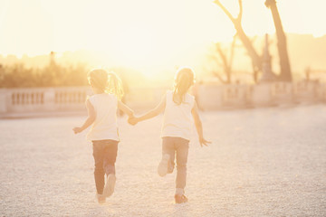 Two young friends running on a sunny afternoon