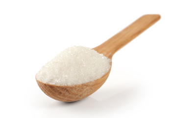 Spoon with sugar on a white background.