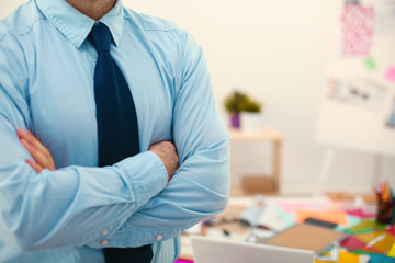 Businessman standing arms crossed