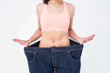 Woman showing her waist after losing weight