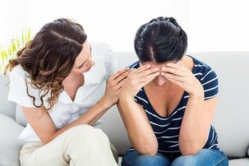 Therapist comforting her patient