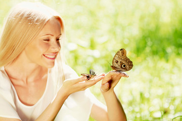 Woman playing with butterfly