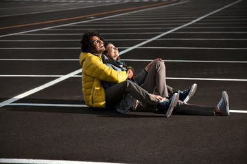 couple in love sitting on an endless road